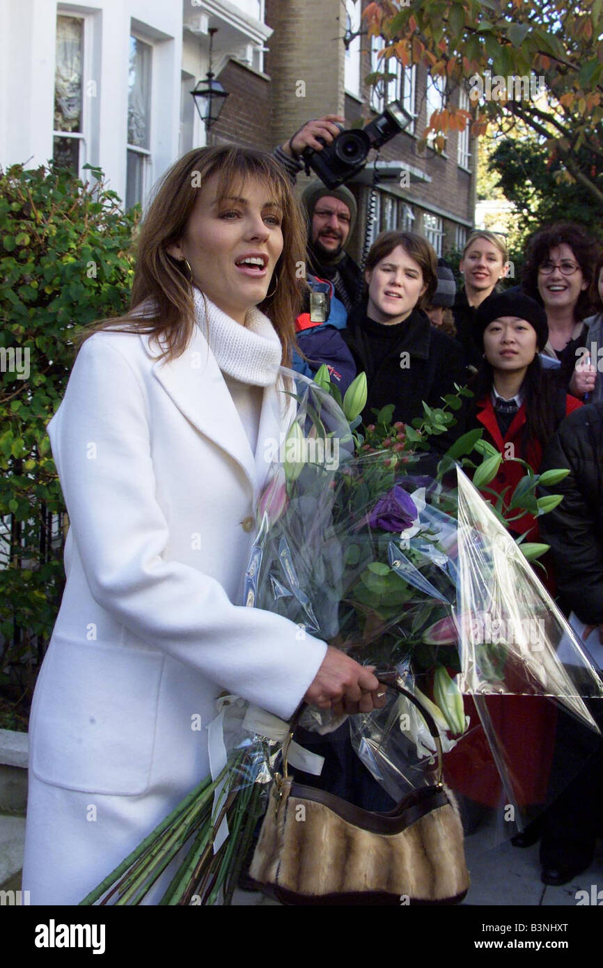 Liz Hurley leaving her home in Chelsea London with Mirror flowers November 2001 - Stock Image