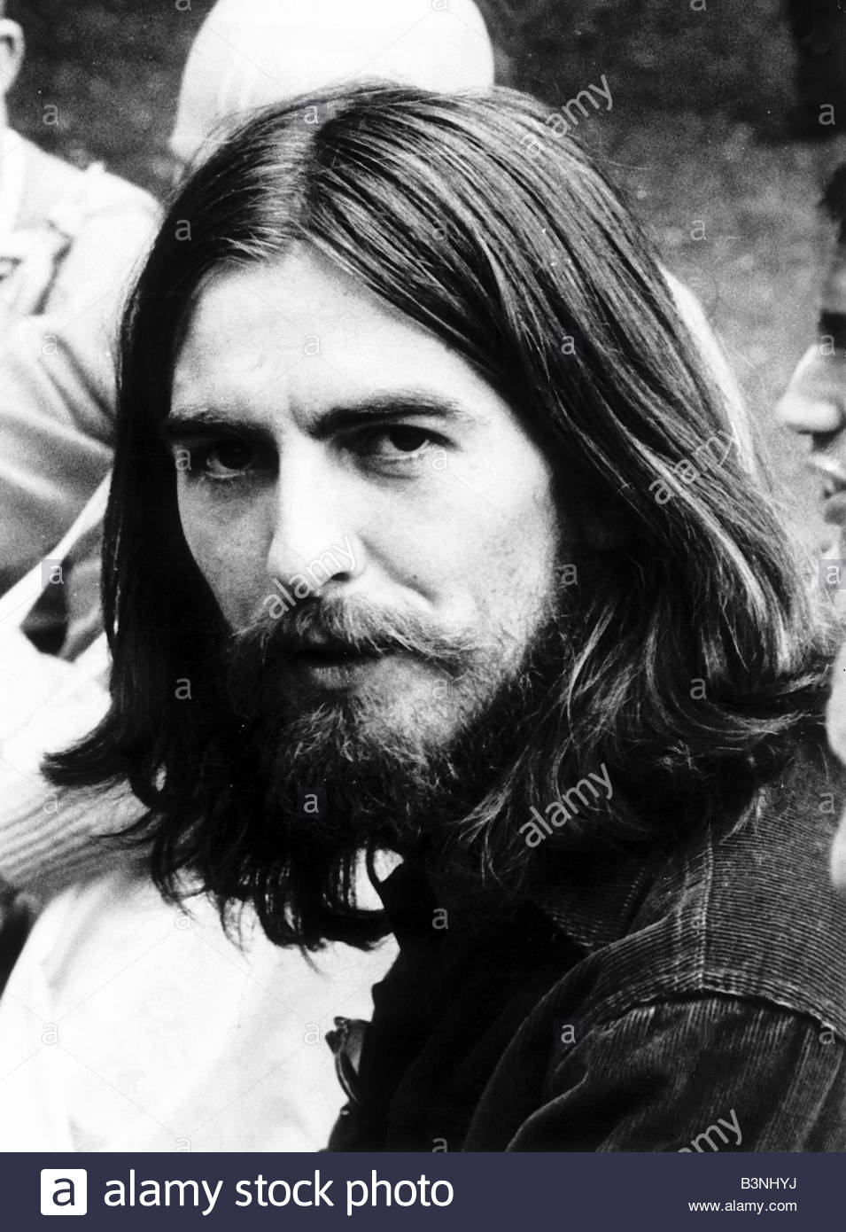 George Harrison singer with the Beatles pop group with long hair and beard Circa 1969 - Stock Image