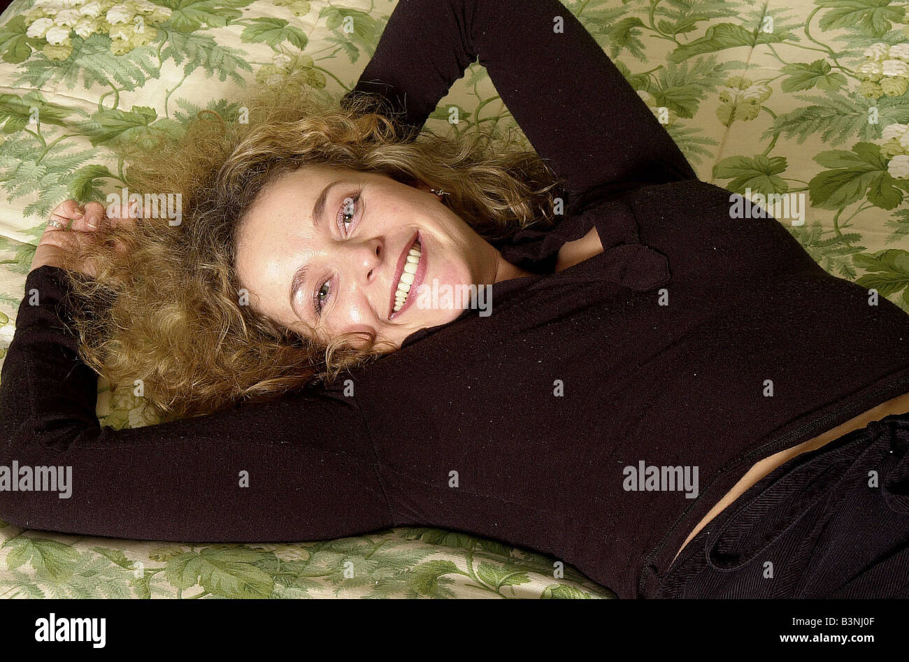 TV actress Julia Sawalha January 2002 Pictured in London Lying on a bed - Stock Image
