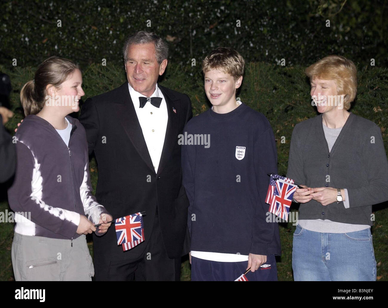 President Bush visit London November 2003 meeting Tom and Claire Hartley and their mum Lucy at Wingfield House - Stock Image