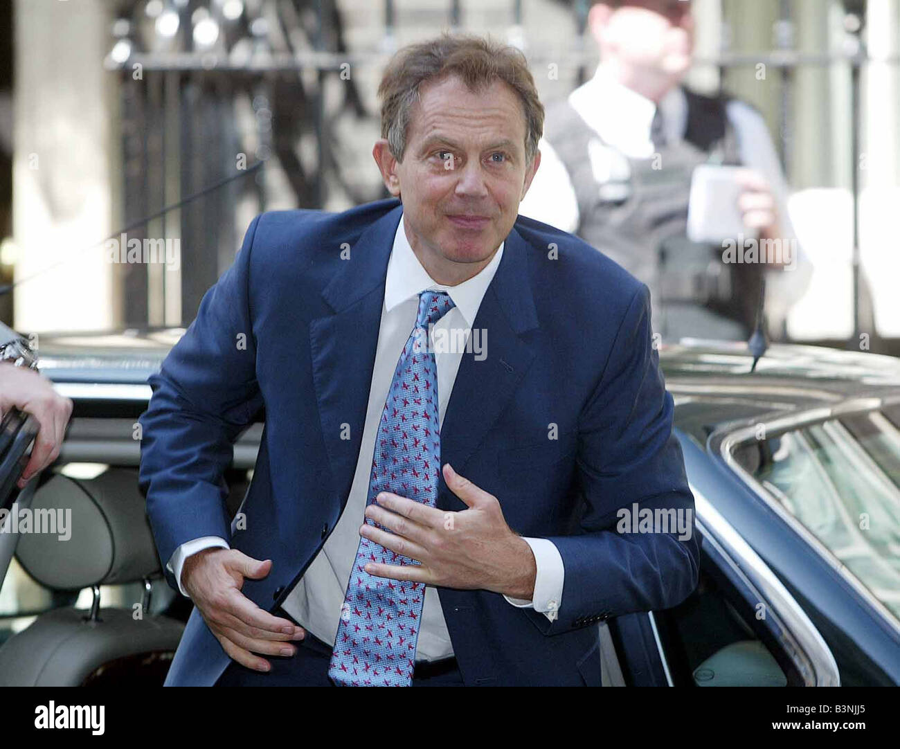Tony Blair getting out of a car wearing blue suit May 2004 - Stock Image