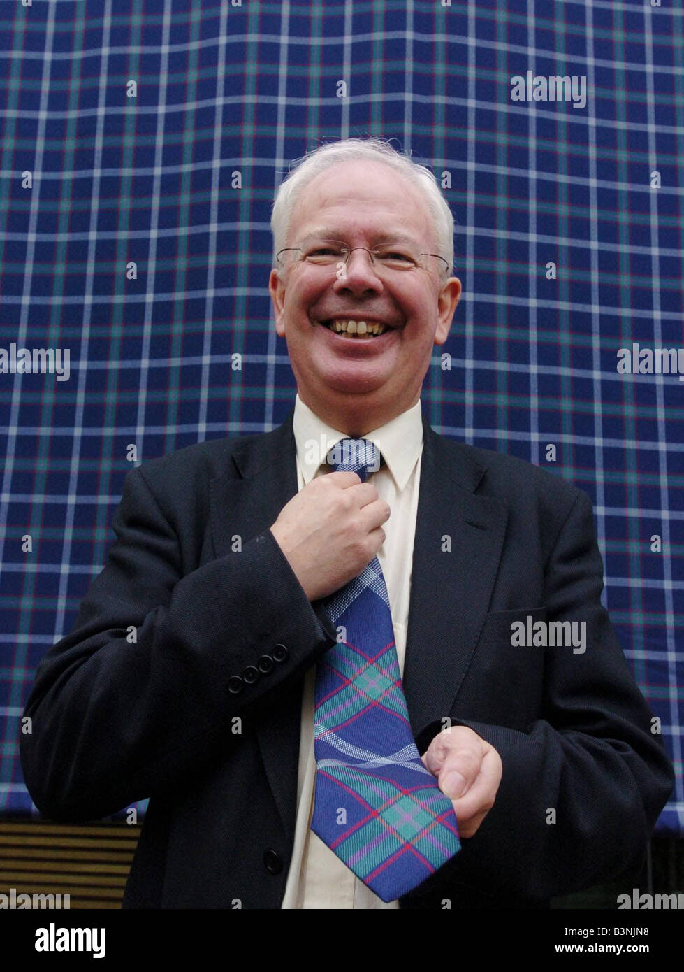 Deputy first minister Jim Wallace unveils G8 tartan in March 2005 - Stock Image