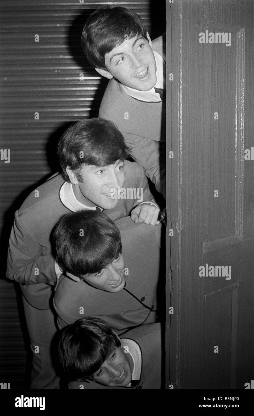 The Beatles peering out from behind a door Top to bottom Paul McCartney John Lennon George Harrison and Ringo Starr 1963  sc 1 st  Alamy & The Beatles peering out from behind a door Top to bottom Paul Stock ...