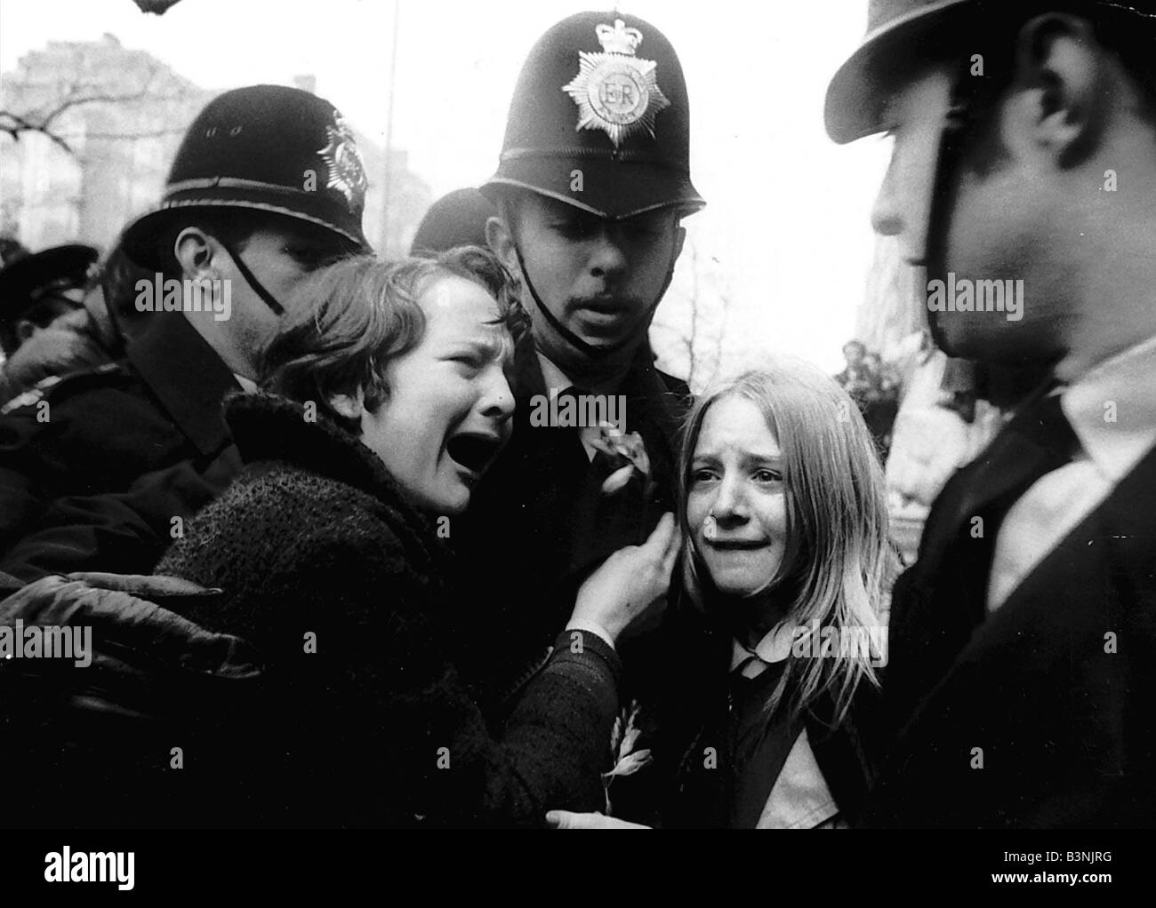 Upset Beatles fans crying because Paul McCartney got married are led away by police March 1969Stock Photo