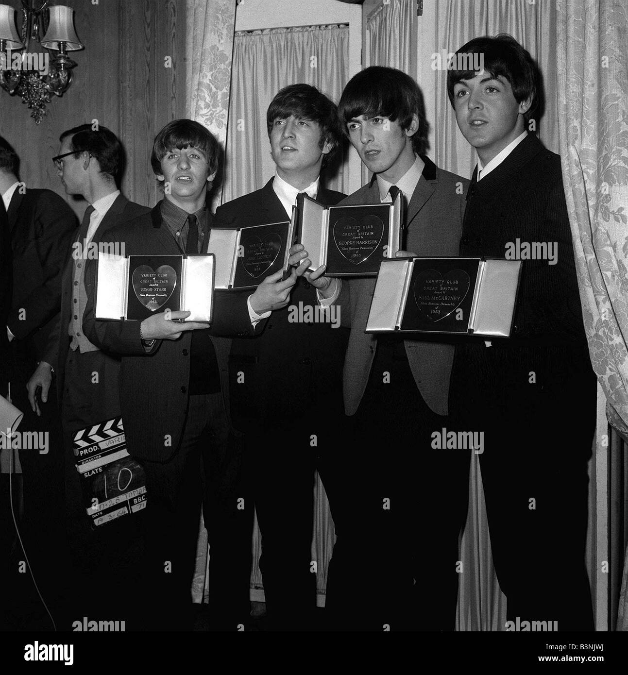 The Beatles L R Ringo Starr John Lennon George Harrison And Paul McCartney Holding Their Awards At