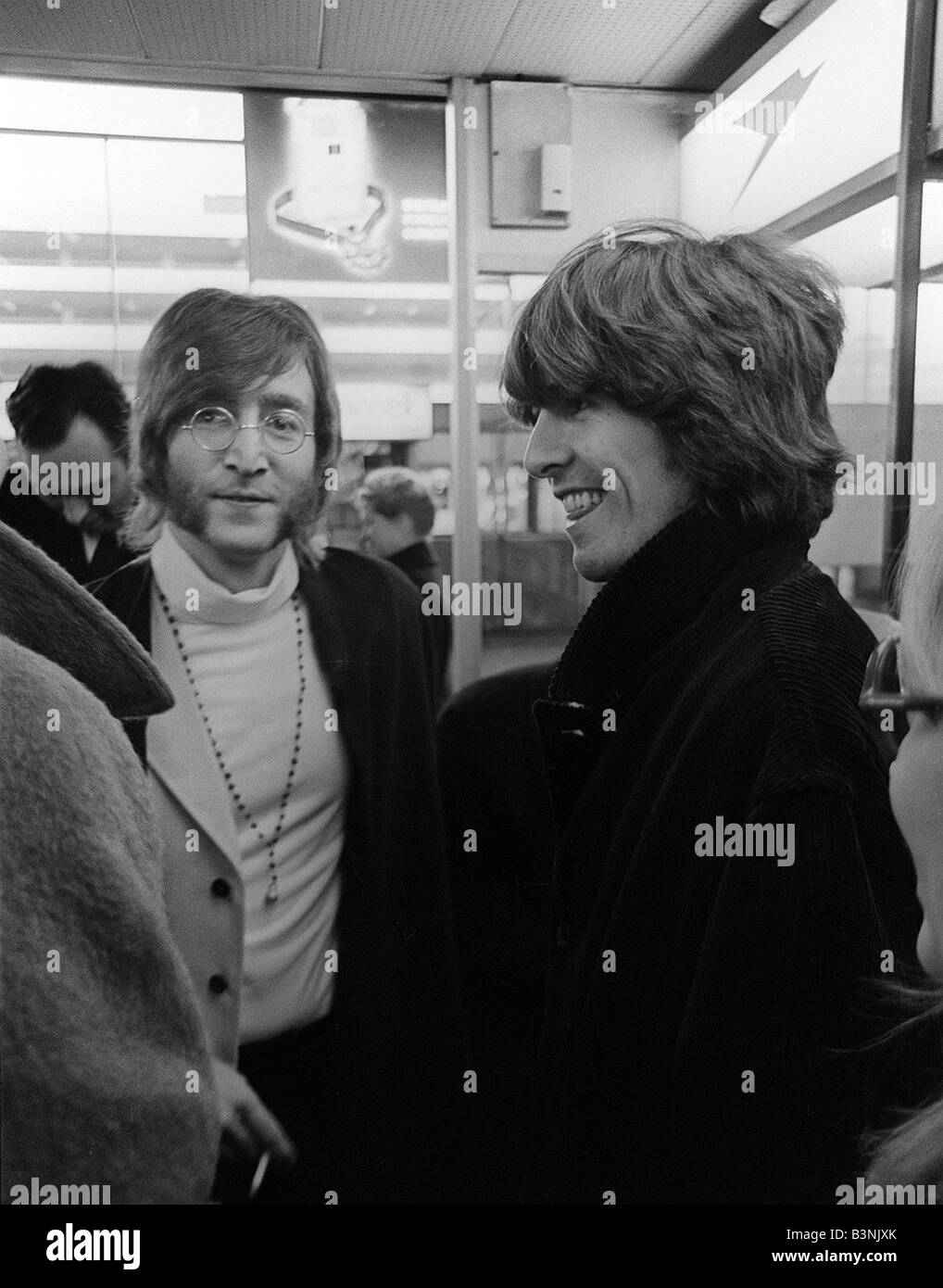 Beatles John Lennon And George Harrison At Heathrow Airport Before Departing To India February 1968