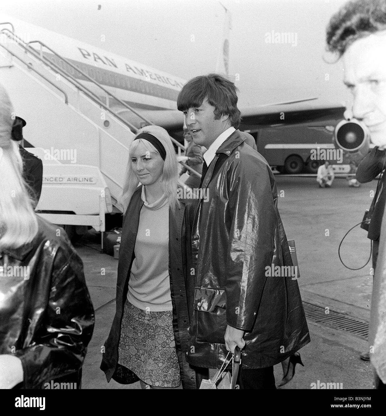 Singer with the Beatles John Lennon with wife Cynthia Lennon at London Airport Circa 1964 - Stock Image