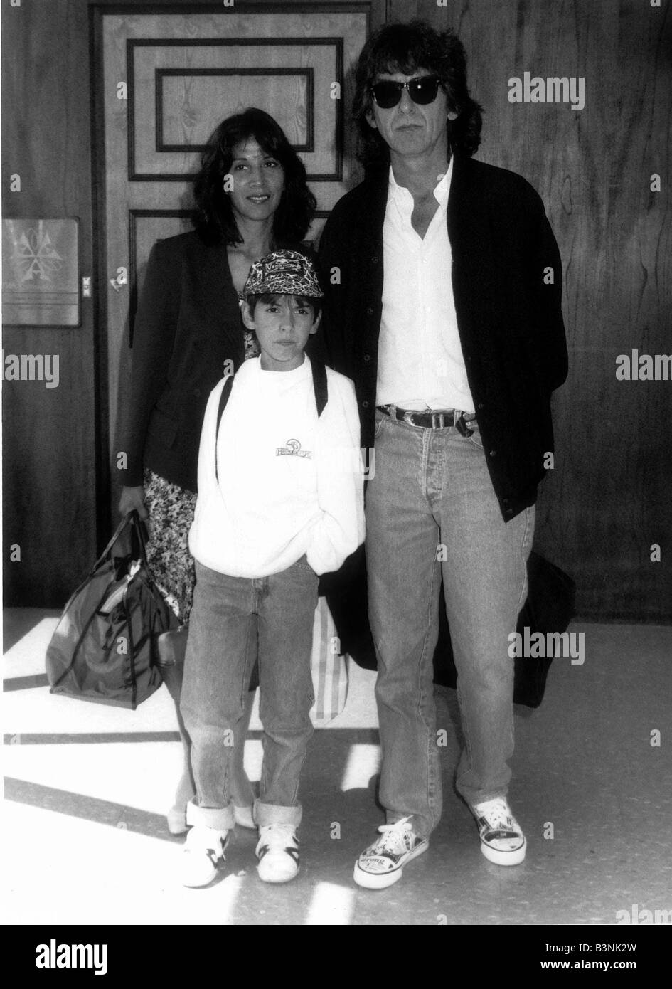 George Harrison formerly of the Beatles with family at London Airport August 1989 - Stock Image