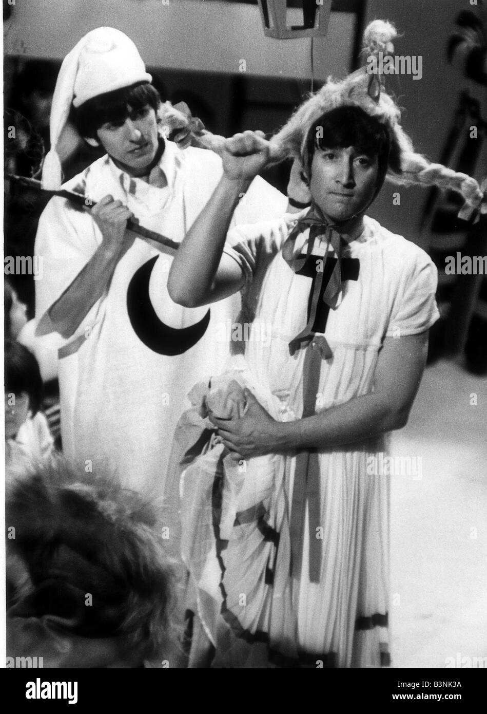 John Lennon and George Harrison of the Beatles rehearsing a scene from a midsummer night dream with additional dialogue - Stock Image