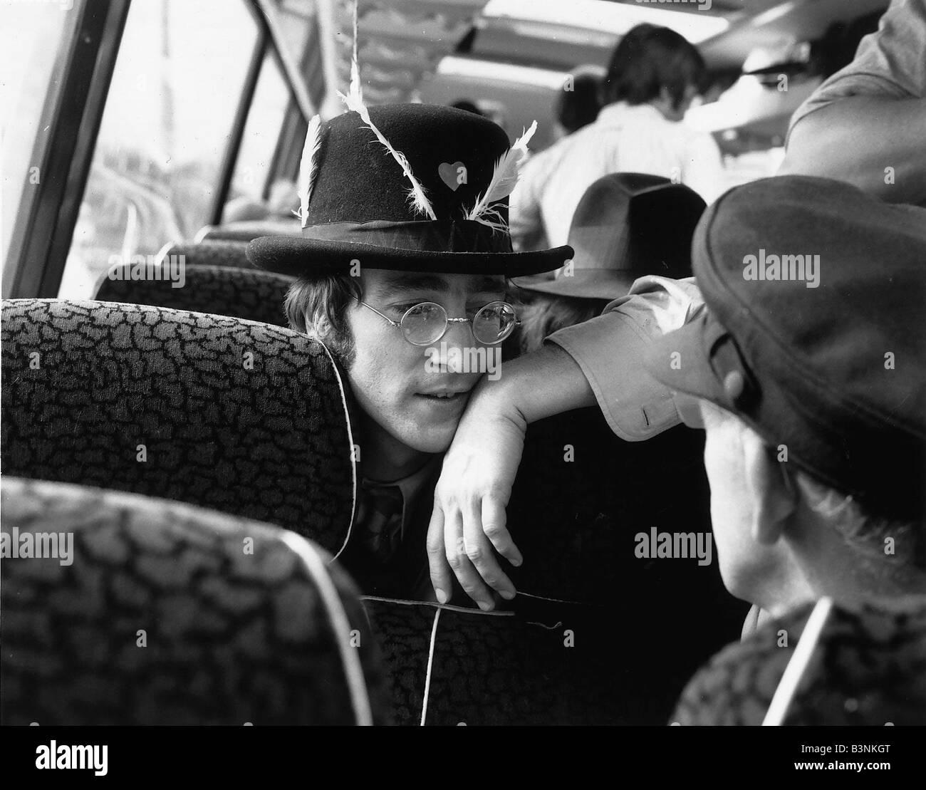 Beatles Pop Group Band Member John Lennon Talking To A Friend On The Coach September 1967 - Stock Image