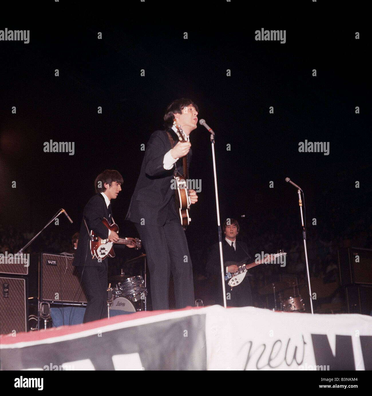 The Beatles on stage at the NME Pop Festival Circa 1964 Stock Photo