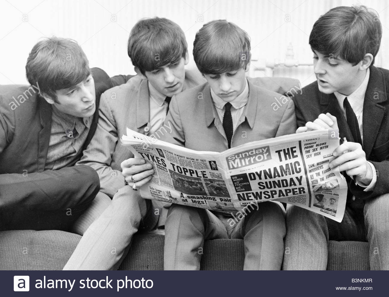 Beatles Files 1963 John Lennon Paul McCartney George Harrison And Ringo Starr Reading The Sunday Mirror Backstage At ABC Cinema In Plymouth November
