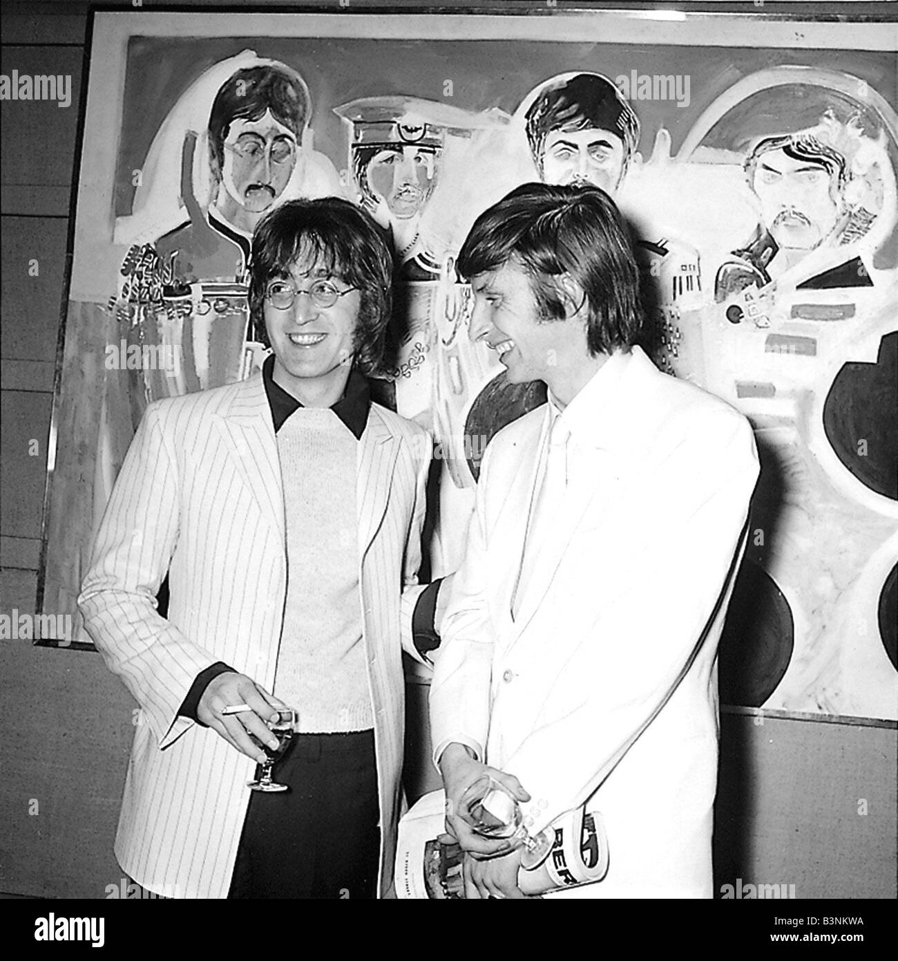 Beatles files 1967 John Lennon with artist Jonathon Hague at an art  exhibition at the Royal Institute gallery December 1967