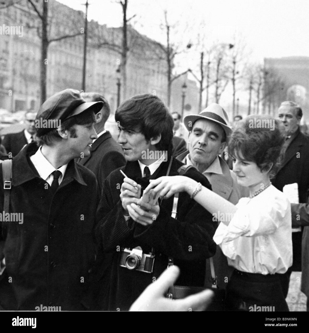 Beatles Files 1964 John Lennon George Harrison Sign Autographs For Fans During The Visit To Paris January