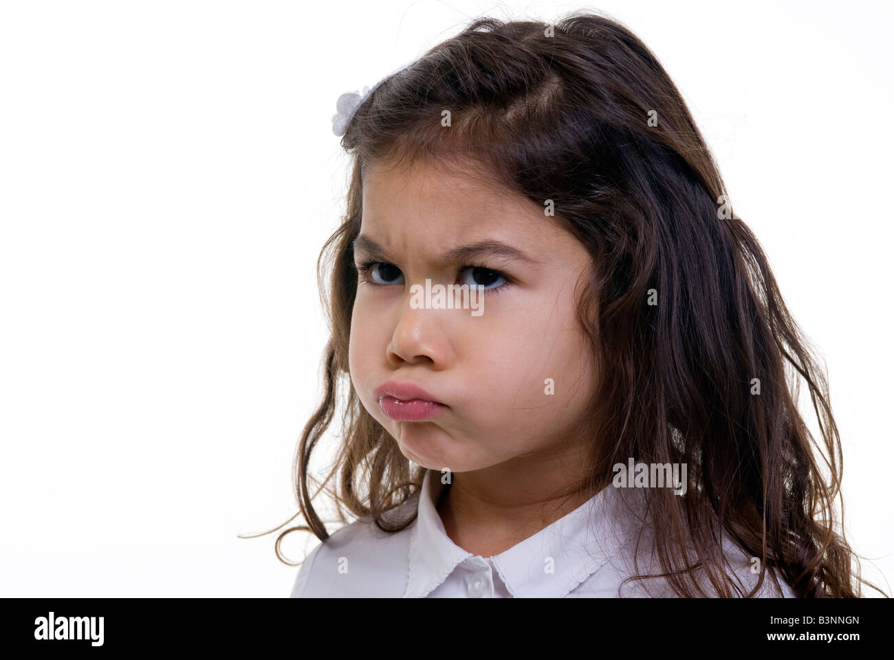 A young girl is pouting about something - Stock Image