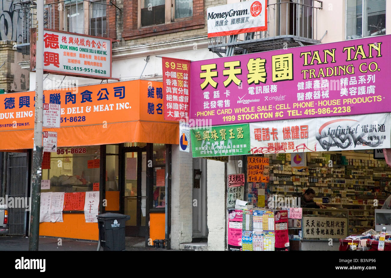 San Francisco California Bilingual signs on stores in Chinatown - Stock Image