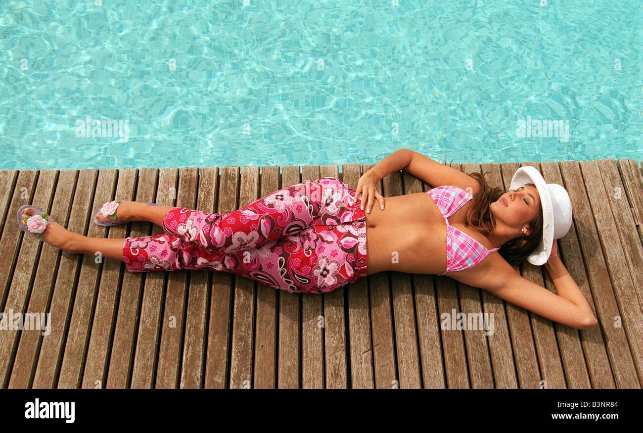 Swimwear fashion May 1999 Pink check bikini pink flowery print trousers - Stock Image