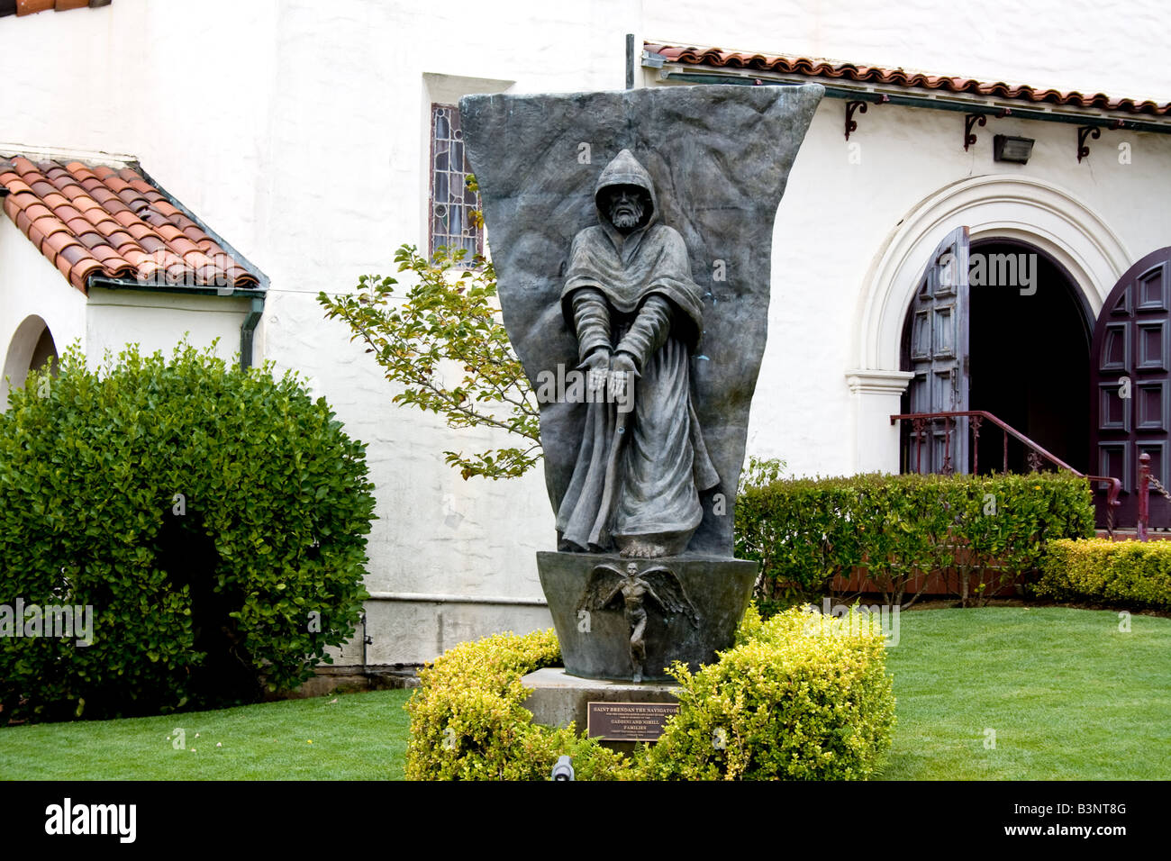 Statue of Saint Brendan the Navigator in front of a church - Stock Image