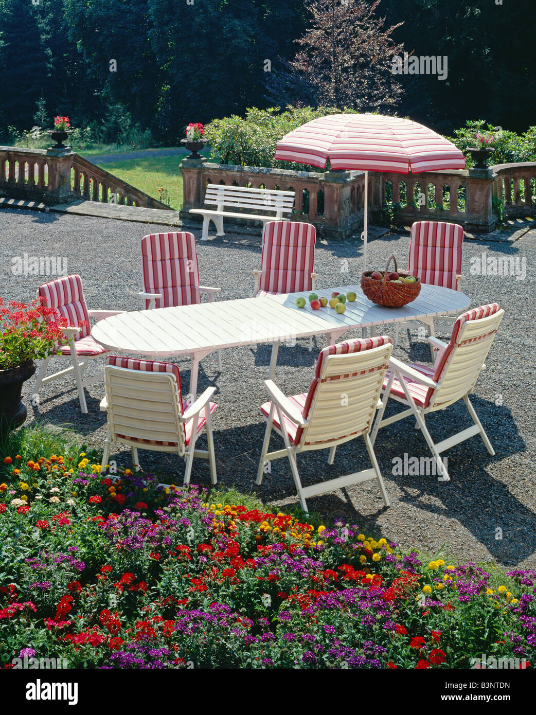 GARDEN FURNITURE ARMCHAIRS AND PARASOL DECORATED WITH PINK STRIPED FABRIC