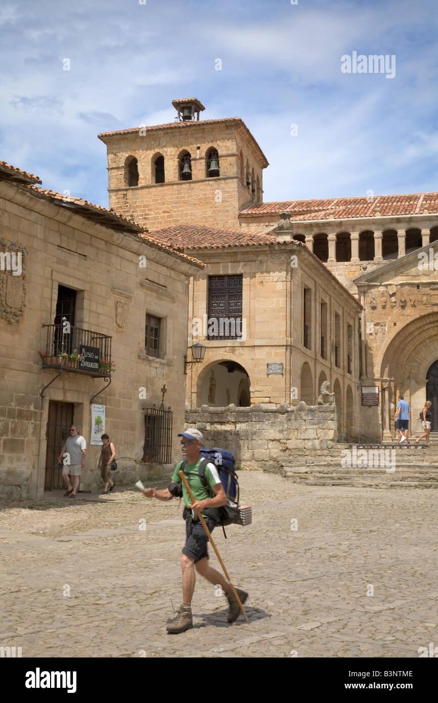 A pilgrim walking through Santillana del Mar en route to Santiago de Compostela Cantabria Spain - Stock Image