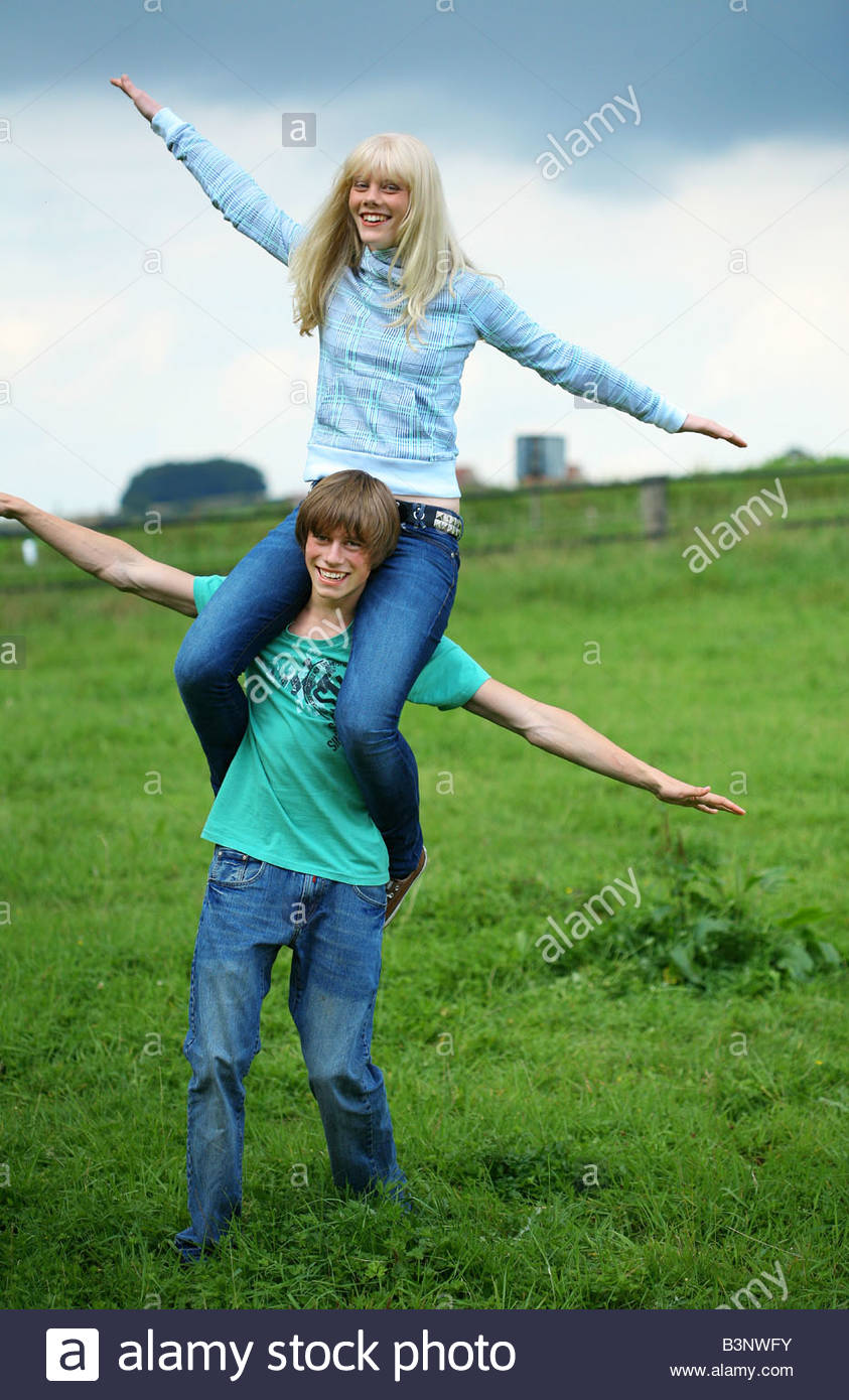 young man carrying his girl friend on his shoulders Stock Photo