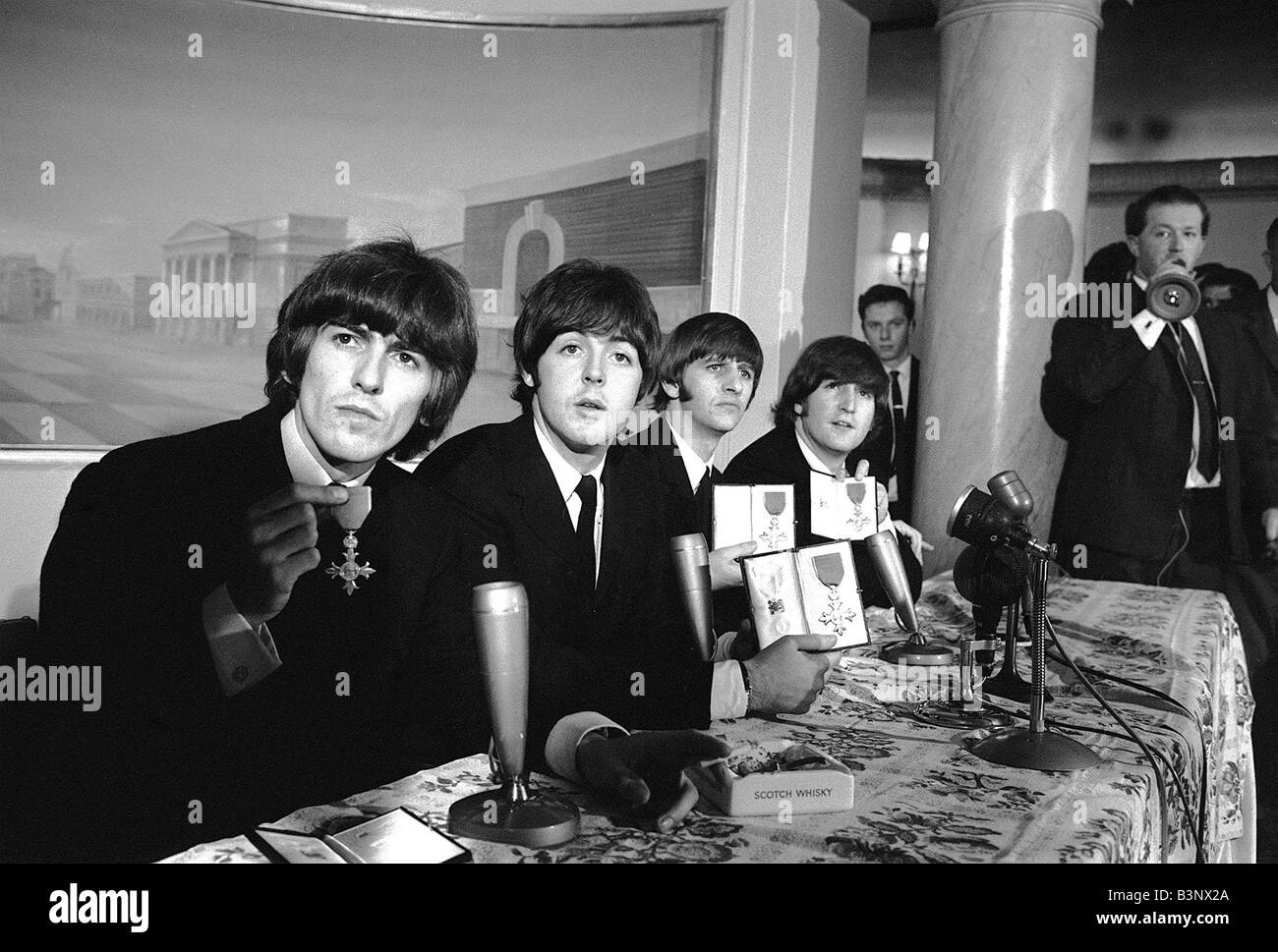 John Lennon Paul McCartney Ringo Starr George Harrison Of The Beatles During A Press Conference After Receiving Their MBE S At Buckingham Palace October