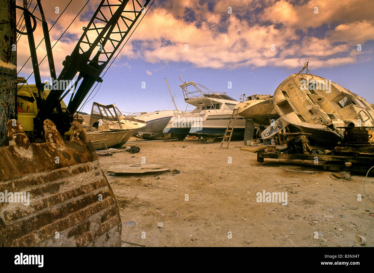 Shipwrecks on a shipyard after a hurricane in the Caribbean - Stock Image