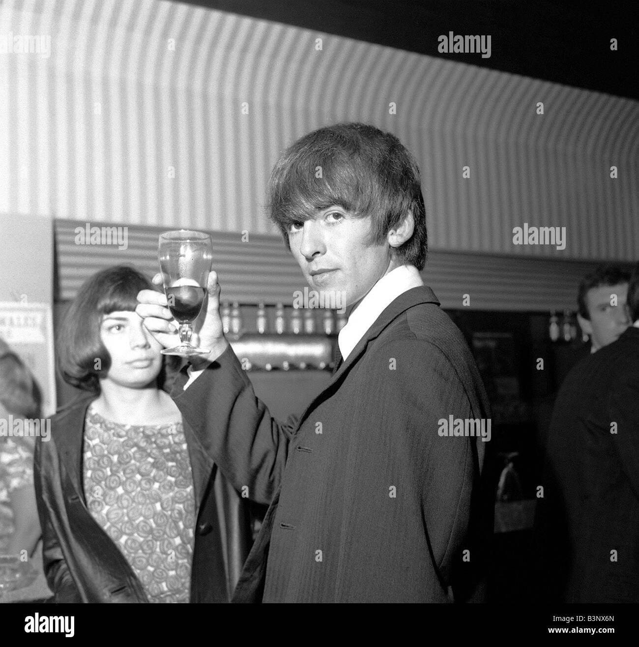 The Beatles May 1964 George Harrison Raises His Glass At Prince Of Wales Theatre Leicester Square London