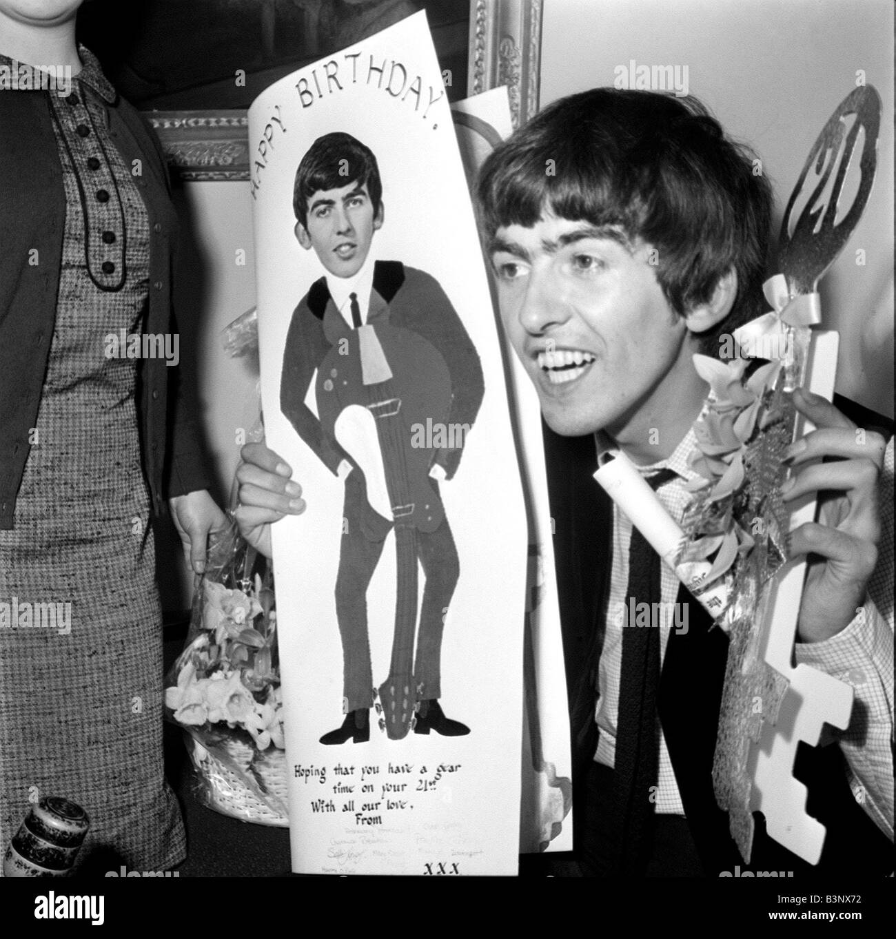 The beatles february 1964 george harrison sorting through the 52 the beatles february 1964 george harrison sorting through the 52 sacks full of greeting cards and parcels on his 21st birthday m4hsunfo