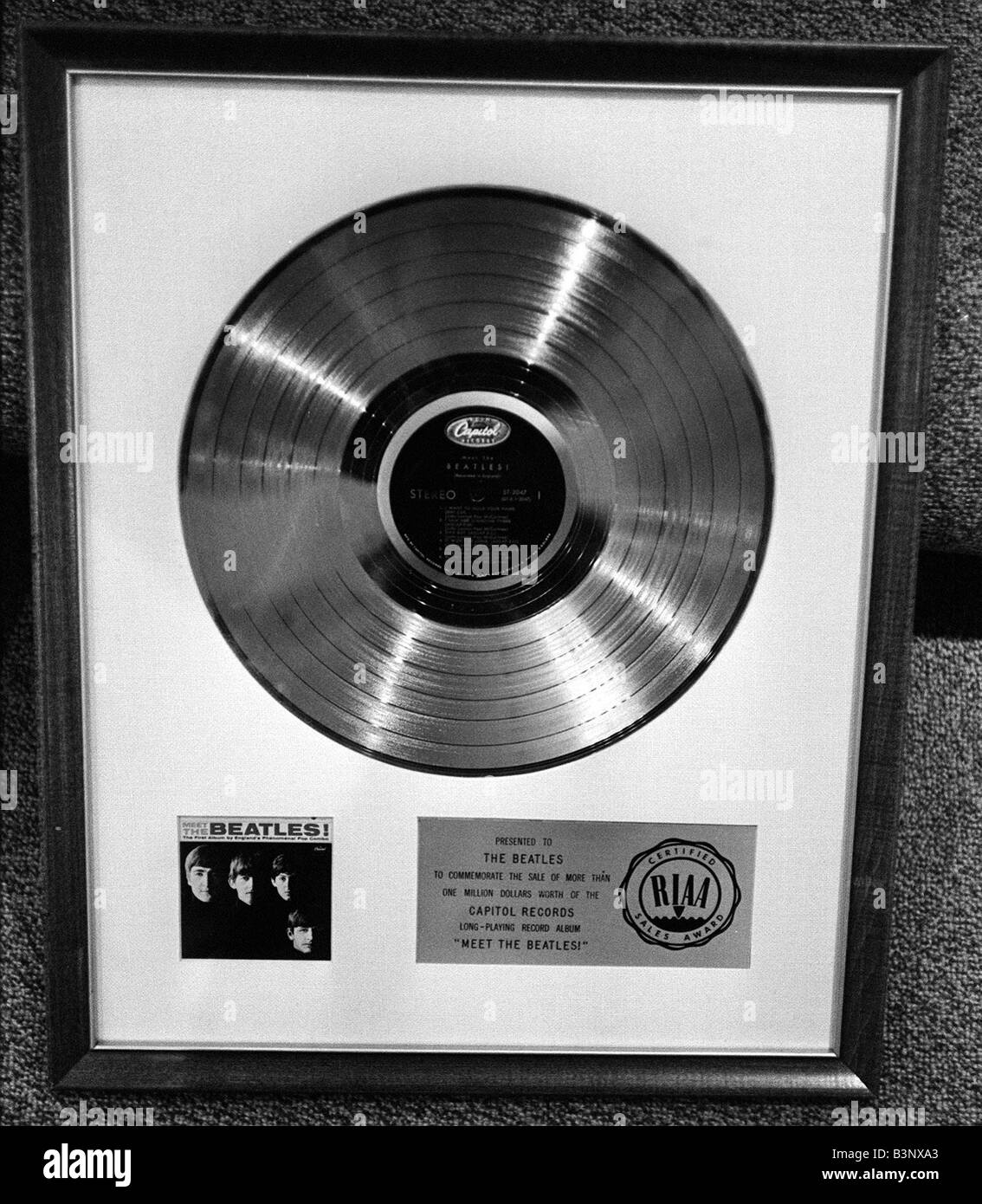 The Beatles February 1964 The Beatles disc awarded to The Beatles to commemorate the sale of more than One Million - Stock Image
