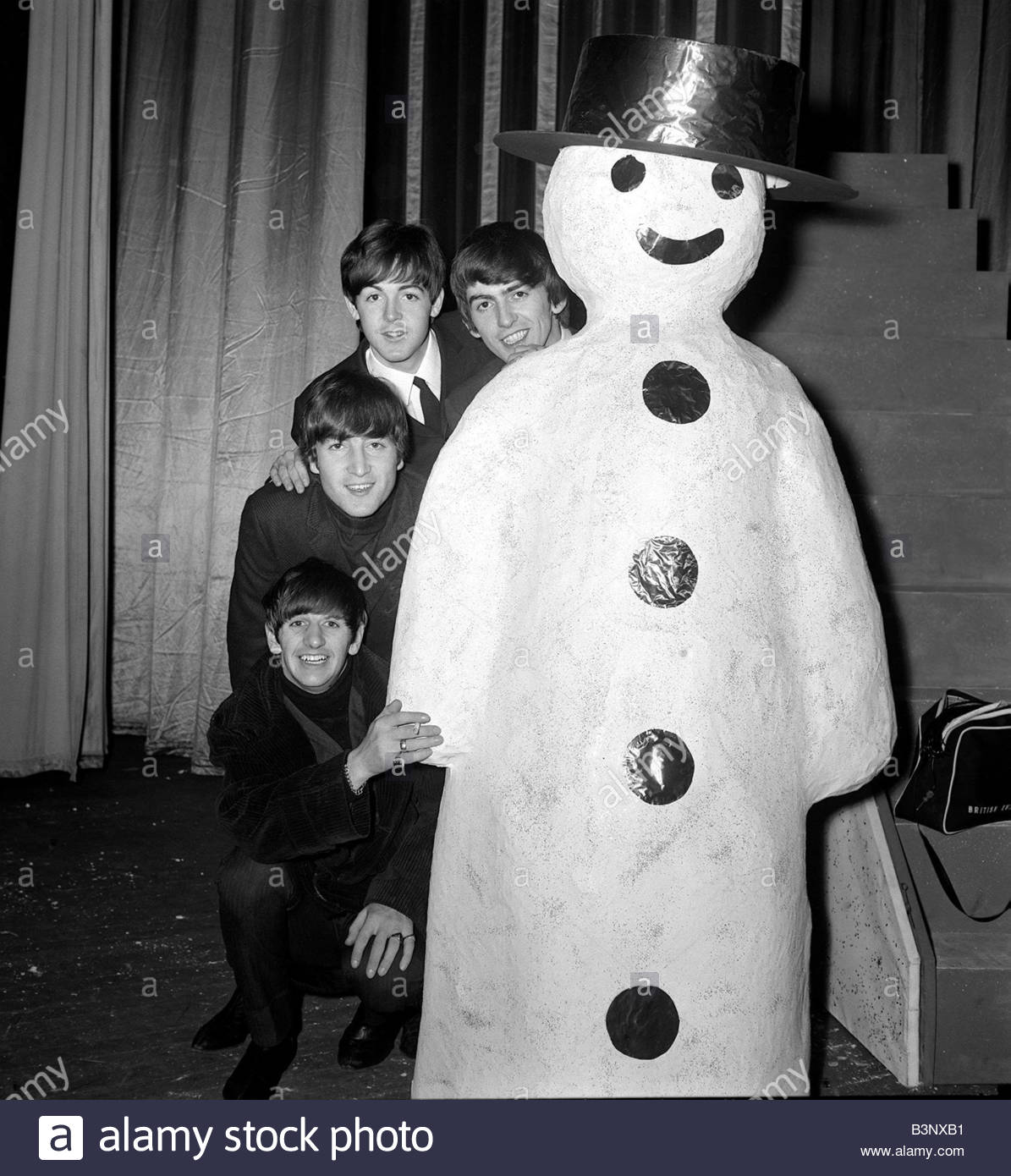 The Beatles December 1963 meet a snowman at the Finsbury Park Astoria where they are rehearsing for the Christmas - Stock Image