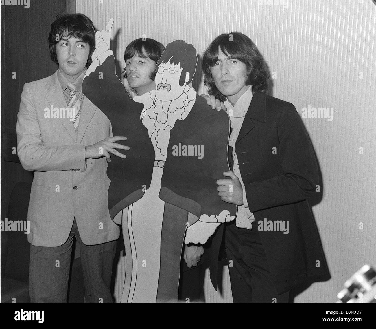 The Beatles 1968 Left To Right Paul McCartney Ringo Starr And George Harrison With A Cardboard