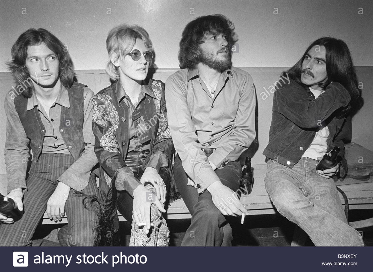 George Harrison with Eric Clapton left and Delaney and Boniie George and Eric took low key roles on the couples - Stock Image