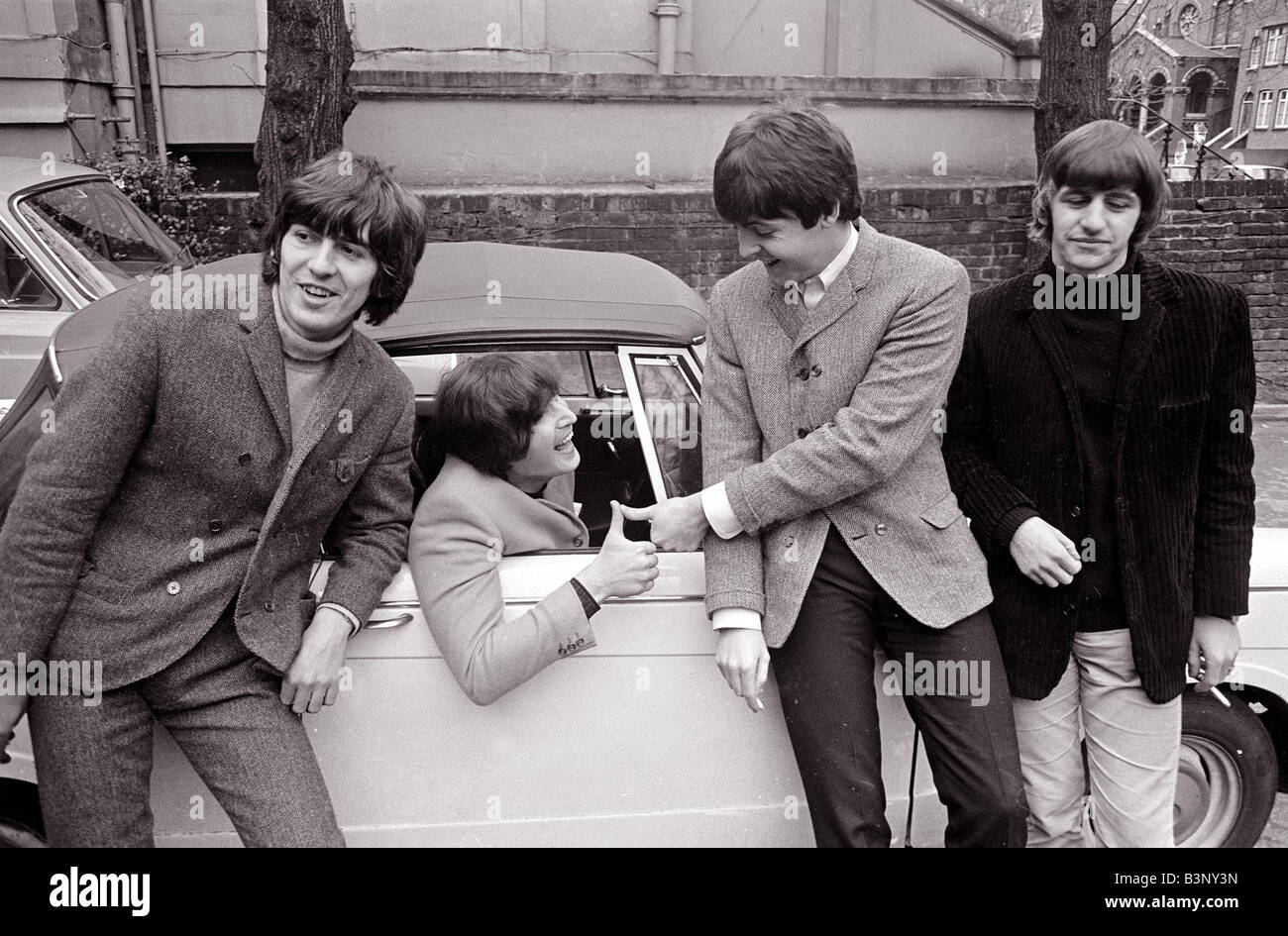 The Beatles by John Lennon s car after he passed his L test 15th February 1965 L R George Harrison John Lennon in - Stock Image