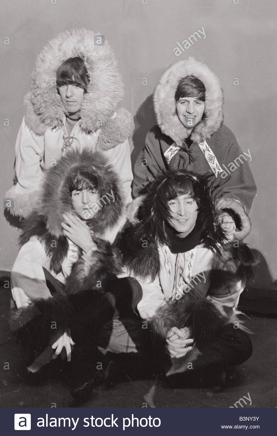 Beatles group shot wearing eskimo outfits 23rd December 1964 Top row George Harrison left and Ringo Starr Bottom - Stock Image