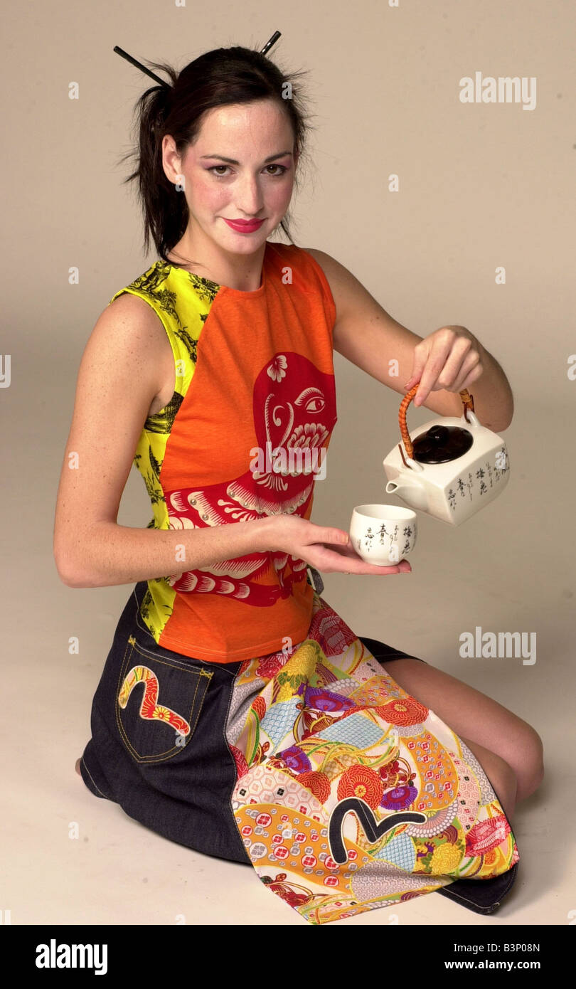 9186f6d5ded73 World Cup Fashion May 2002 A Model wearing Oriental print denim skirt and  orange printed T Shirt holding a Tea set
