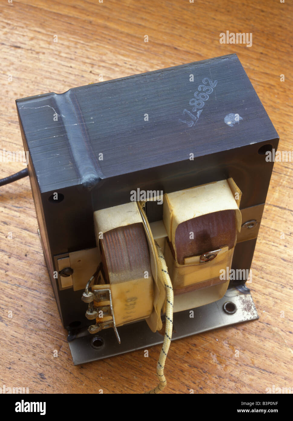 laminated transformer to reduce eddy currents - Stock Image