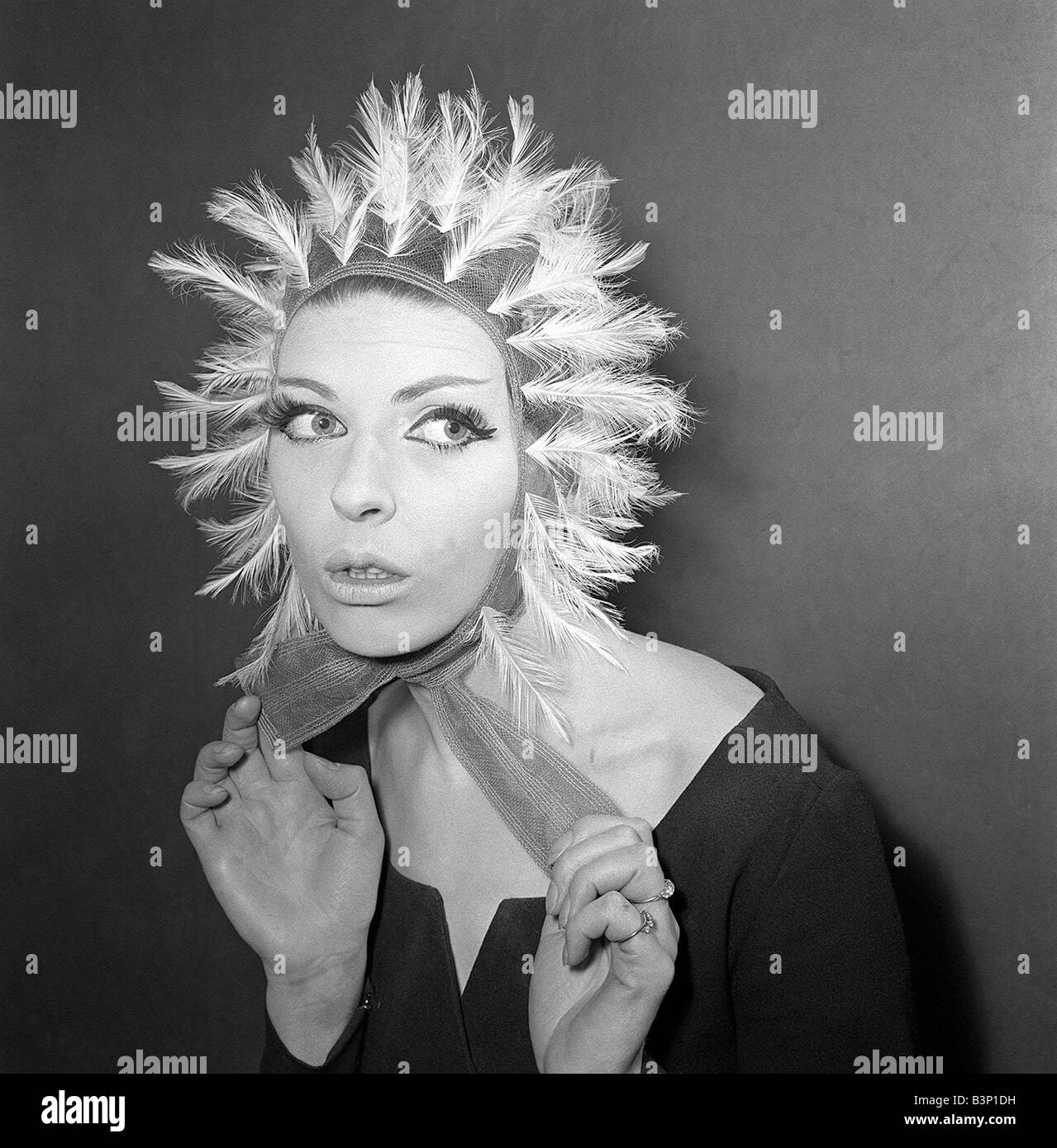 Clothing Fashion Hats January 1964 A Reed Crawford tulle helmet made of a burnt heron feathers Model Lois JamesStock Photo