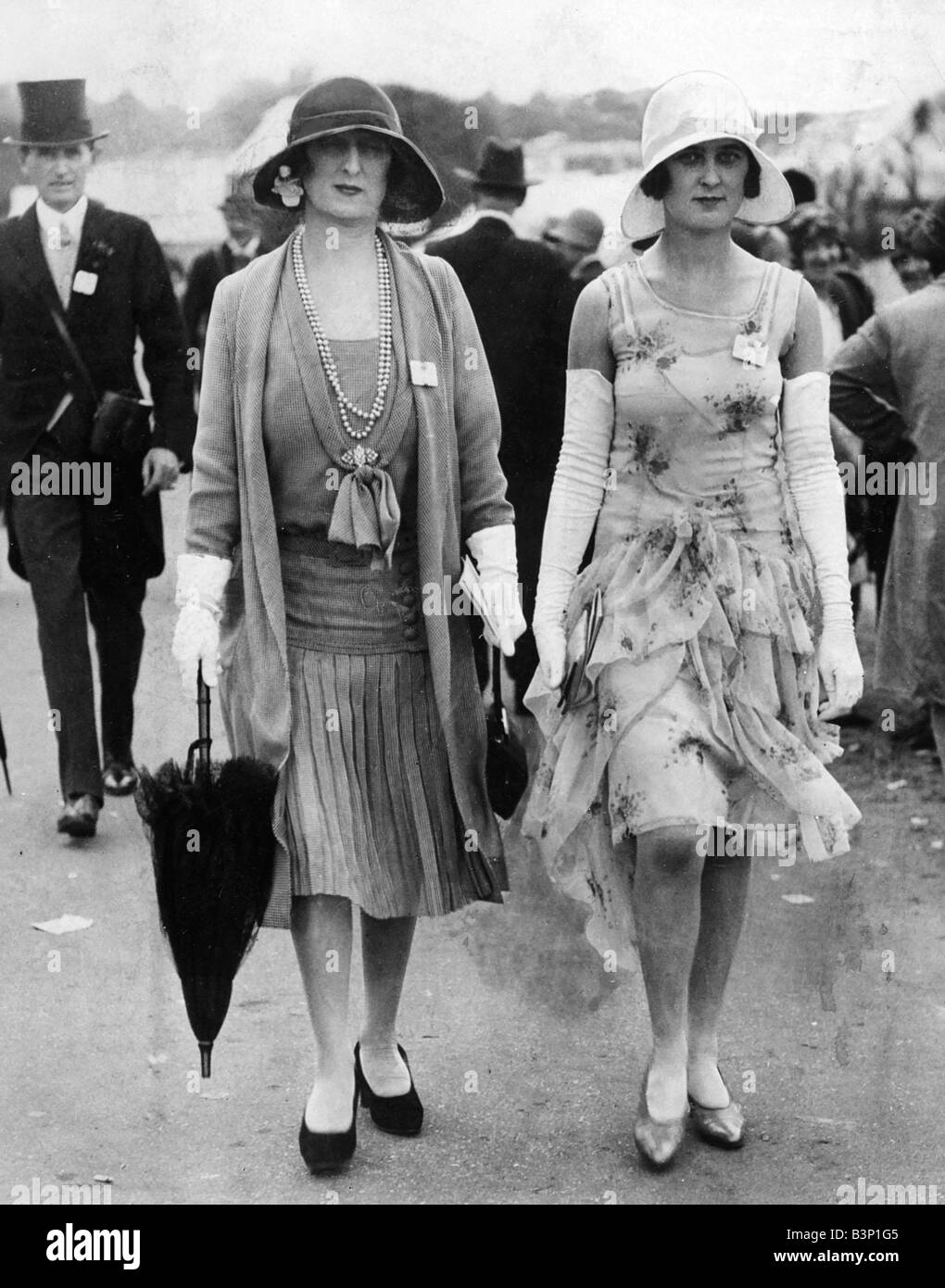 1929 Clothing Ascot Fashions Women wearing dresses with cardigans chiffon  ruffle skirt detail long gloves carrying an umbrella