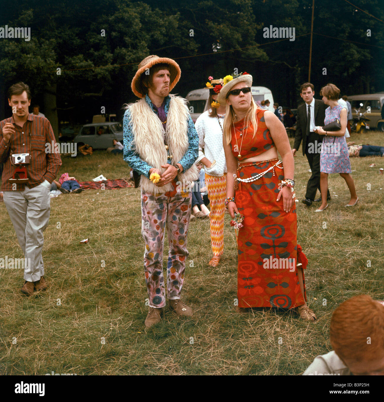 Sixties Fashion 1960s Clothing Hippies At Flower Festival Fur Waistcoat Hat Sunglasses Floral Trousers And Dress Mirrorpix