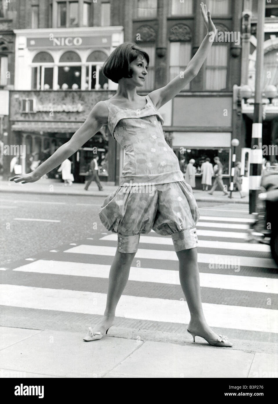 Model Victoria vaughan stops traffic in london wearing a suit designed by Mary Quant She is wearing silk patterned bloomers with snowflakes of pink turquoise and beige at Quant s autumn dress show September 1961 fashion unusual pattern colour woman ladies 1960s sixties 6 9 61 msi Stock Photo