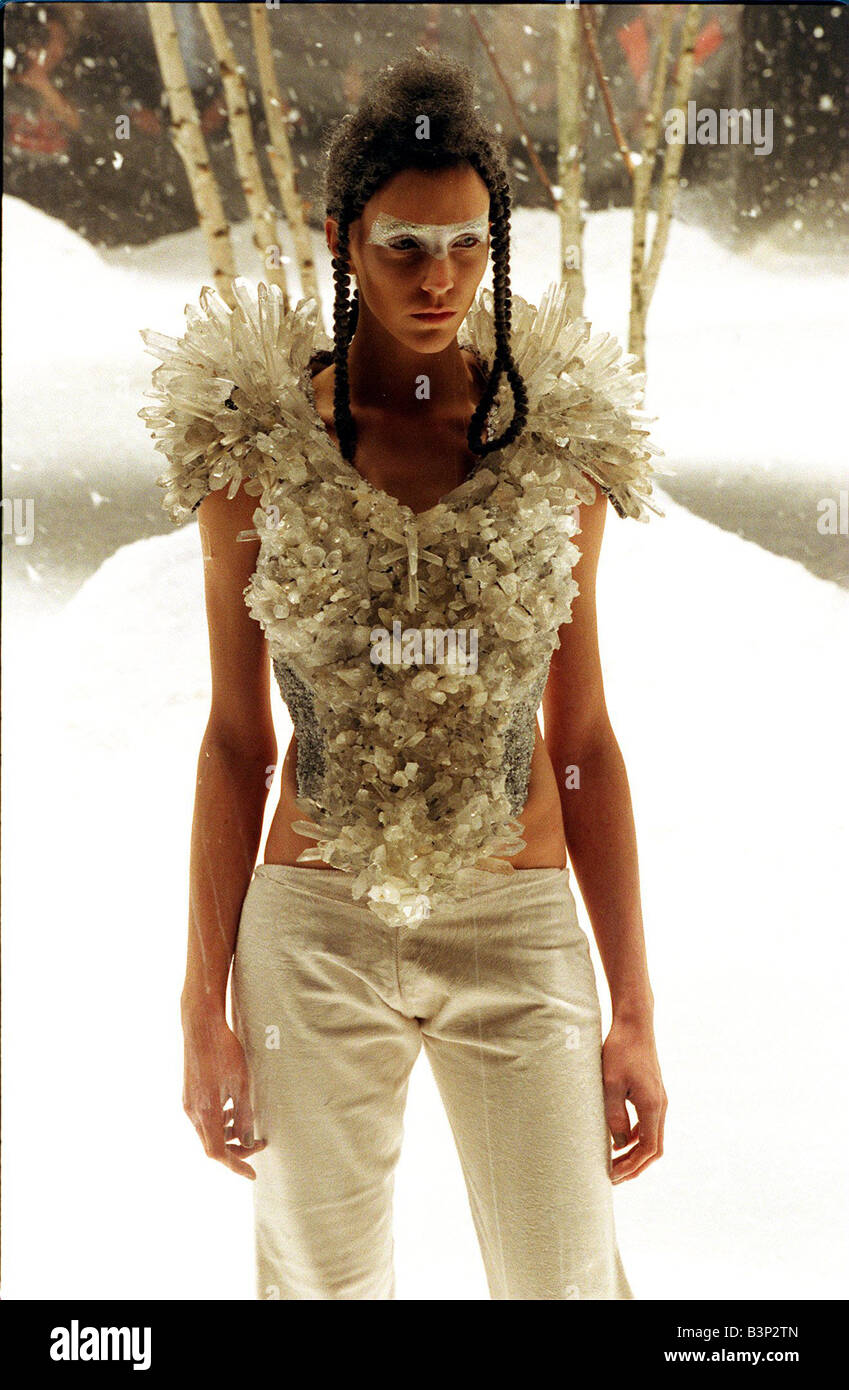 Alexander McQueen autumn winter collection February 1999 Model wearing a ruffled corset style top with trousers Stock Photo