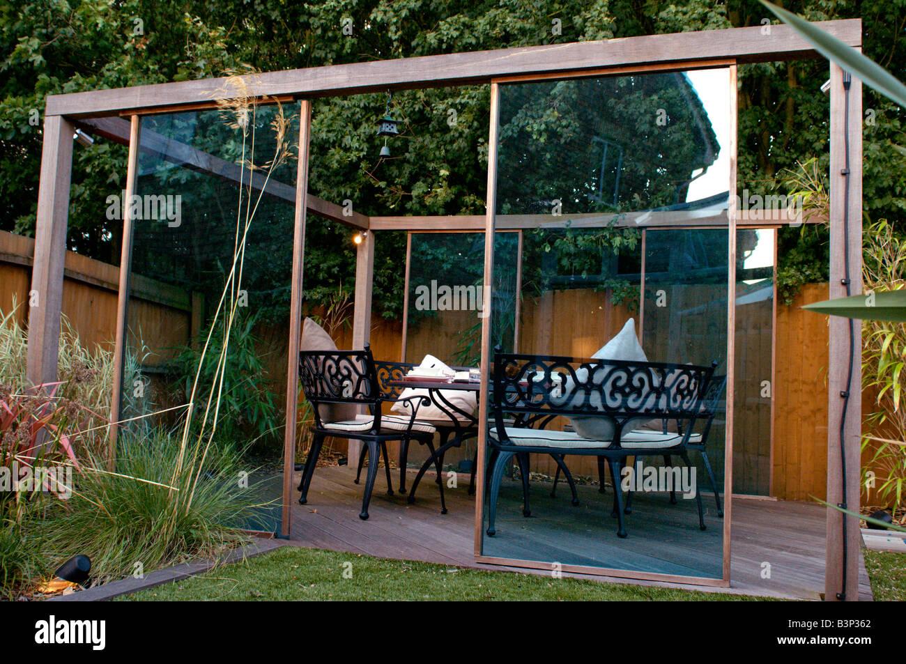 Perfect Outdoor Dining Set Under Gazebo In Modern Landscaped Garden