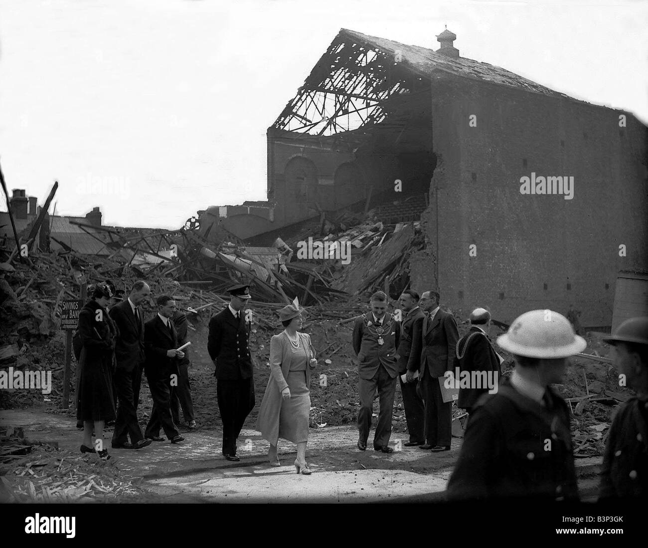 King George VI and Queen Mother visit Hull August 1941 looking at Bomb damage during WW2 - Stock Image