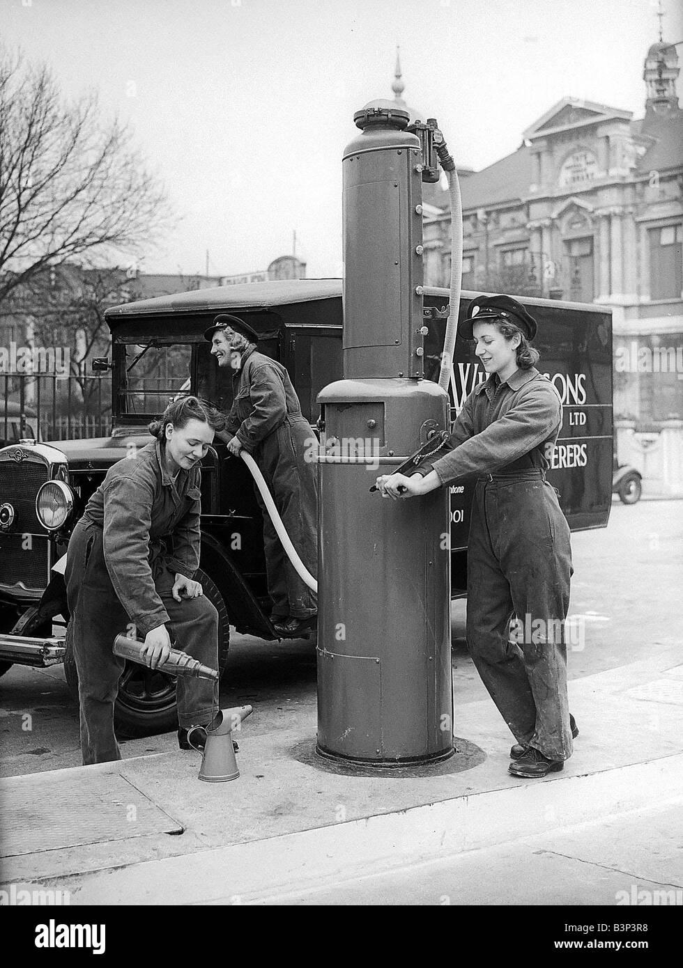 Women Garage Workers filling van with petrol in 1941 women doing mens jobs during the war years Women at War WW2 - Stock Image