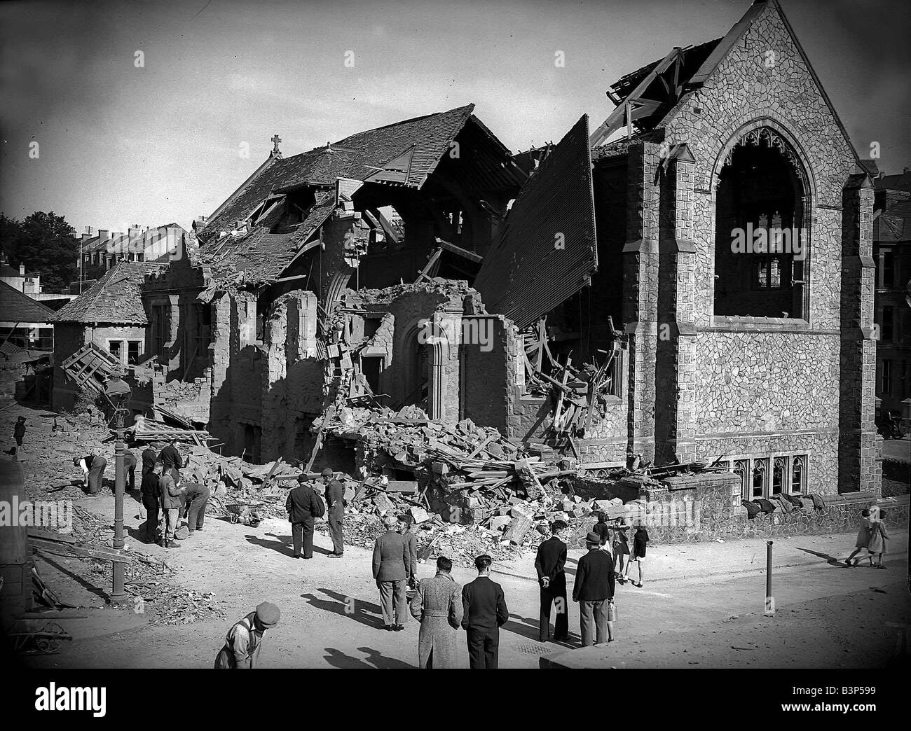 Bomb damaged Grimsby during WW2 People survey the damage left after an air raid bomb - Stock Image