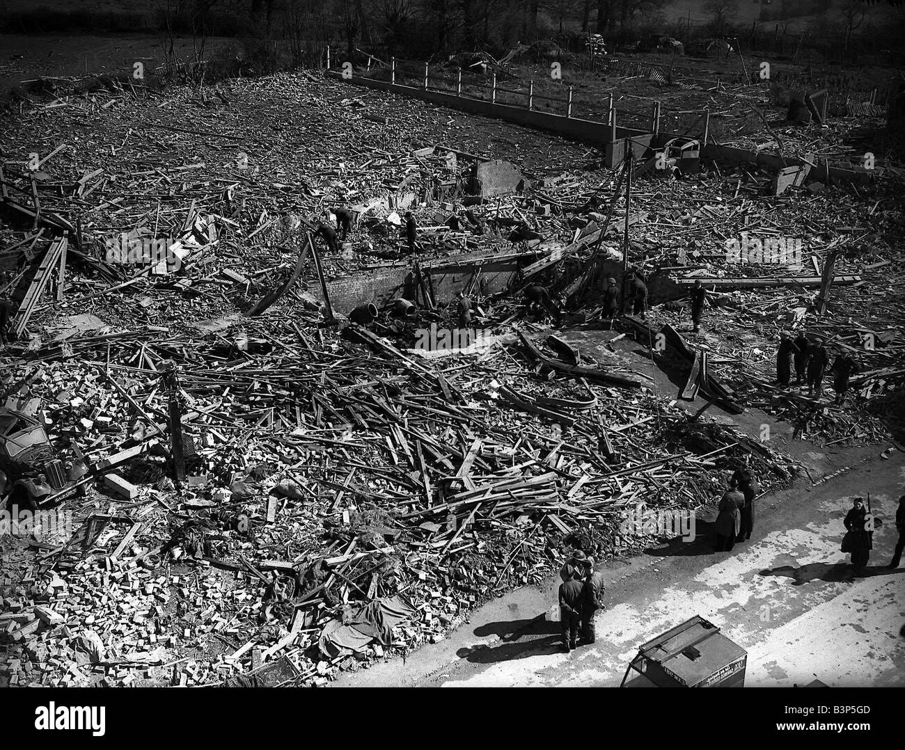 WW2 Bomb Damage at Chigwell absolute destruction where buildings used to stand the site is now a pile of rubble - Stock Image
