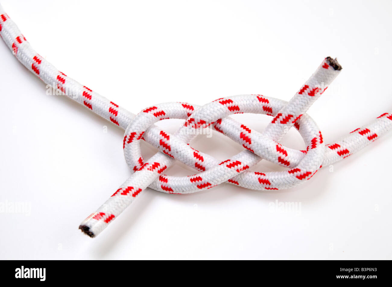 The Carrick Bend or The Josephine Knot AKA Sailor s Knot and Anchor Bend on white background - Stock Image