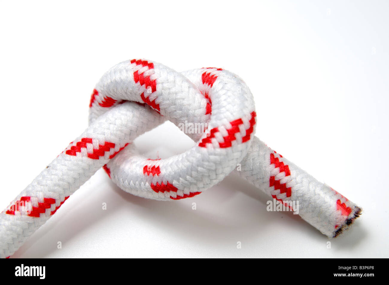 Overhand Knot on white background - Stock Image