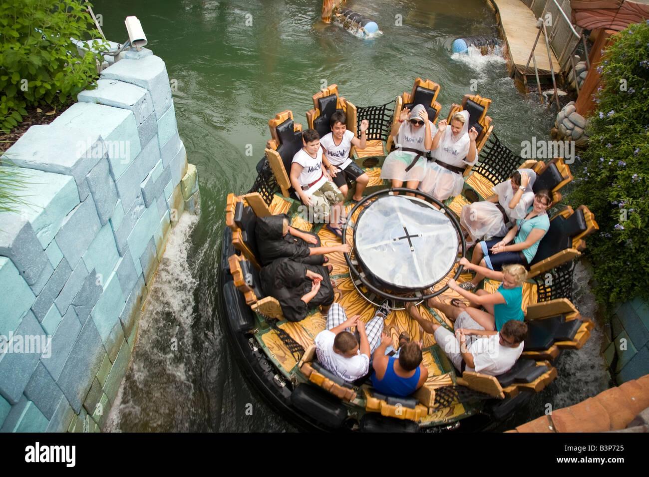 Tourists enjoying water rapids ride inside Universal Studios theme park Florida, USA - Stock Image